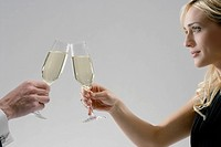 Woman and man toasting with champagne