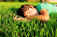 boy relaxing on grass