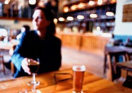 Out of Focus Woman in a Winebar
