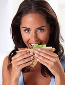 Woman Eating Sandwich Lunch