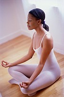 Woman in Yoga Pose on Hardwood Floor
