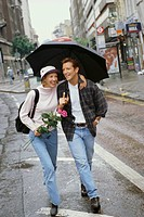 Couple Walking with Umbrella in City