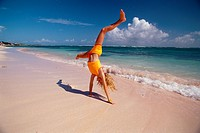 Girl Cartwheeling on Beach