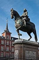Statue of Philip III with the Casa de la Panaderia in the background in the Plaza Mayor, central Madrid, Spain