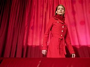 A woman in red, in a red room
