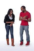 Studio portrait of young African American couple having fun on white background
