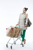 Woman Pushing Shopping Cart With Groceries