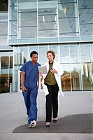 Doctor and co_worker looking at digital tablet