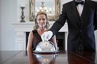 Waiter holding lid