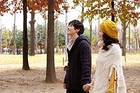 Young Couple Walking In A Park In Autumn
