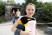 Girl Holding a Stuffed King Penguin
