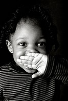Young Girl with Hand Over Mouth