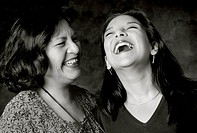 Laughing Mother and Adult Daughter