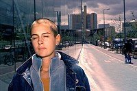 Young Woman with Shaved Head in City