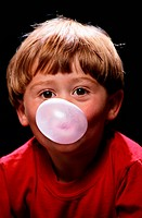 Boy Blowing a Bubble with Bubblegum