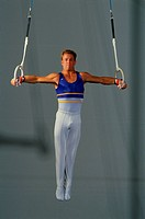 Gymnast Competing in Rings Competition