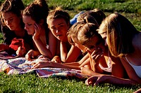 Teenage Girls Talking on Grass