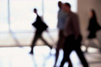 Businesspeople Strolling Hallway
