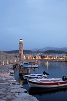 Old venetian port with light house in the evening, Rethymnon, Crete, Greece