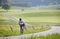 Cyclist near Muensing, Bavaria, Germany