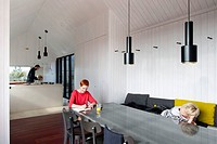 Shingle House, Dungeness, United Kingdom. Architect Nord Architecture, 2011. Dining room and open plan kitchen.