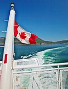 A view of the stern of a ferry going to Victoria showing the Canadian flag