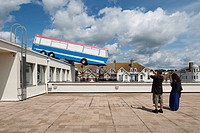 Hang On A Minute Lads, I´ve Got A Great Idea..., Bexhill, United Kingdom. Architect Richard Wilson, 2012. View from roof terrace with couple taking pi...