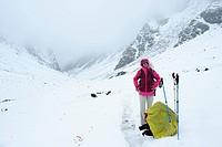 Woman standing on snow_covered path, Shingo La, Zanskar Range Traverse, Zanskar Range, Zanskar, Ladakh, Jammu and Kashmir, India