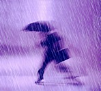Businessman Running in the Rain