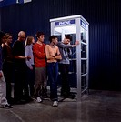 Waiting to use the pay phone