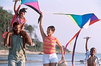 Family flying kites on the beach