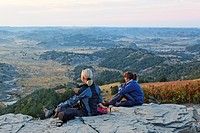 Two women sitting on the rocks, Theodore Roosevelt National Park, Medora, North Dakota, USA