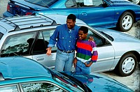 Father and son buying new car