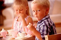 Kids Eating Cookies at a Tea Party