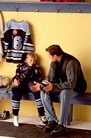 Father and son talking about hockey