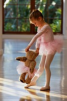 Young Ballerina Playing with Teddy Bear