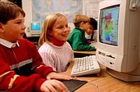 Children using computers in school