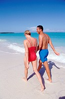 Couple walking on the beach _ Bahamas