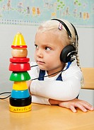 Girl with headphones during hearing control