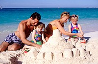 Family building a sand castle