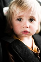 Portrait of boy in car seat