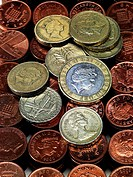 Piles of British pennies with one and two pound coins