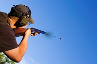 Man shooting with rifle, close_up