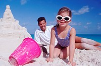 Sand castle and sunglasses