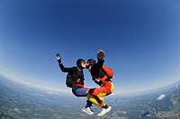 Parachuting couple kissing