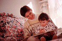 Mother and girl reading together