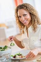 Portrait of woman eating dinner