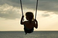Child playing on a swing in Darwin, Australia