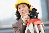 Architect using theodolite