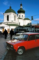 Ukraine, Kiev, Podil district, red Lada parked in the street